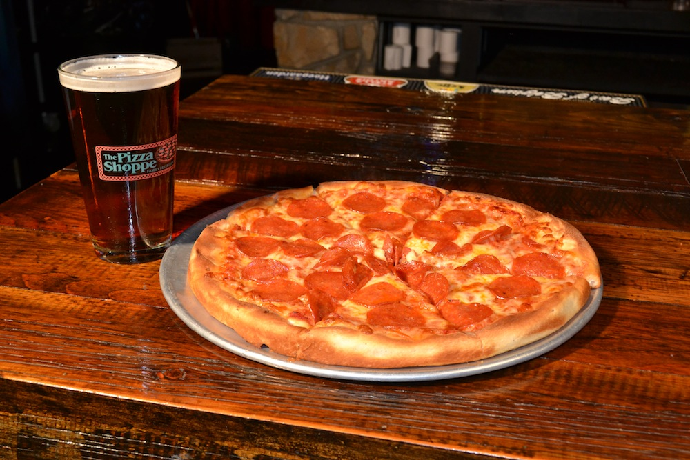 This Is A Picture Of A Beer And A Pepperoni Pizza.